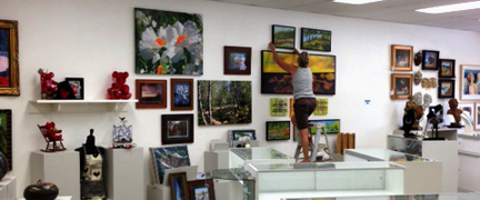Merilee Allen hanging new encaustic work!